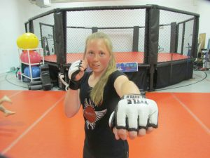 Berthoud's Sierra Suits poses for a photo at Seraphim MMA gym in Loveland. Suits, 16, plans to continue pursuing her goal of becoming a professional mixed-martial-arts fighter. Bob McDonnell/ The Surveyor