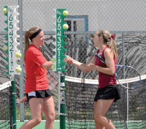 Berthoud's Hannah Nash shakes hands with Skyline's Eryn Coyle after defeating her, 6-2, 6-0, in the first-round consolation match at the Berthoud League Tournament on Friday, April 25. Nash finished the day in second place in no. 2 singles. Surveyor/ John Gardner