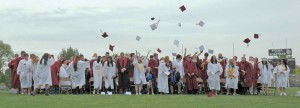 Berthoud High School graduates toss their caps into the air in celebration as 171 Spartans received their diploma at Max Marr field on Saturday, May 24. For more graduation coverage pick up this week's issue of the Berthoud Weekly Surveyor.