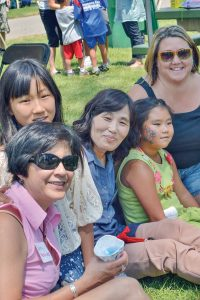 Adoptive mother Sarry Moscatel, adopted daughter Ella, Korean foster mother KeumSoon Yang, adopted daughter Ava, adoptive mother Leslie Seely. This was the first time that the foster mother has seen both Ella and Ava since they were infants in her care at the foster home in Korea. She had pure elation to see them doing well even though there was a language barrier, and the girls did not remember her, the moment was priceless for the families. May Soricelli / The Surveyor