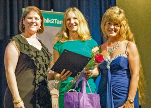 Brandy Mattson and Tami Spaulding presented Caroline Creager, center, with her award at the Colorado Women of Influence ceremony on July 16. Photo courtesy of Colorado Women of Influence