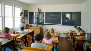 "In the sunny Meadow Hollow School House, Ms. Petrovich leads the class in their mantra for the day, ""Kind hearts are the garden, kind thoughts are the roots, kind words are the flowers, kind deeds are the fruits."" Recitations were a practice used to teach the children through memorization of text and presentation to others. May Soricelli / The Surveyor"