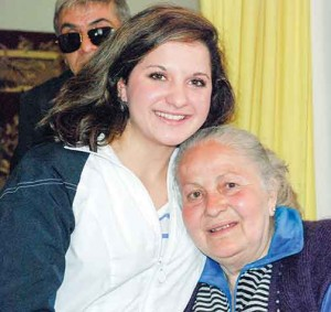 Rhya Stoesz, left, pictured with her biological grandmother in Ukraine in April.