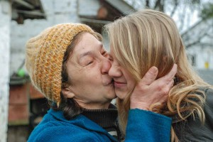 Samantha Stoesz receives a kiss from her biological mother, Lyudmilla Seleznova, while visiting Ukraine in April.