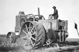 """Ben Green who worked for Sid Davis, paused in the field for a photo on a """"Rumley 6"""" tractor. Davis also used a 1916 Titan tractor in his wheat farming operation. All photos courtesy of the Ludlow Collection/ Berthoud Historical Society"""