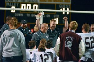 Berthoud head coach Troy Diffendaffer, center, talks to the team after the game Friday in Gilcrest.  John Gardner / The Surveyor