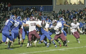 Berthoud defenders overtake Fort Lupton quarterback on Sept. 12. The Spartans won their third contest of the year 42-0.  Karen Fate / The Surveyor