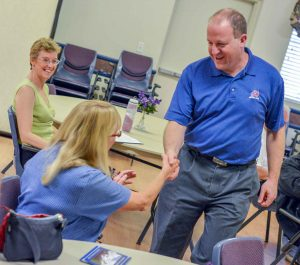U.S. Representative for Colorado's 2nd Congressional District, Jared Polis, shakes hands with residents at a town hall meeting held Aug. 27 at the Berthoud Community Center. About 20 people attended the event.  John Gardner / The Surveyor