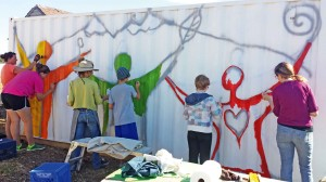 Volunteers turned a blank storage container into  a colorful mural for the Berthoud Habitat for Humanity on 4th Street in Berthoud.  Photo courtesy Meghan O'Brien Marks