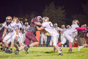 Berthoud defensive end Steele Castles disrupts Frederick's offensive line as the defense stops the Warriors on Oct. 17. The Spartans won the contest 14-0, in large part due to its defense.  John Gardner / The Surveyor