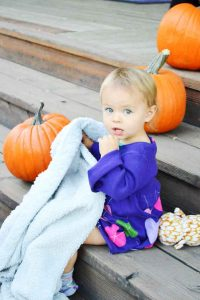 Scarlett Sabin enjoys the warm weather and pumpkin lined steps as she joins her mother Macayla on the patio of the Berthoud Inn at the Farm to Table Dinner.  May Soricelli / The Surveyor
