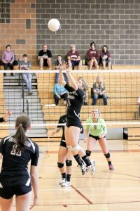 Berthoud setter, sophomore Jessa Megenhardt, jump sets against Bear Creek in the final at the  Golden Volleyball Invite on Oct. 25. Berthoud went undefeated and beat 5A Bear Creek for the title.  Photo courtesy of Dan Megenhardt / The Surveyor