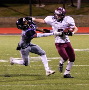 Berthoud's Jimmy Fate stiff arms his oncoming tackler as he runs the ball up field against Discovery Canyon on Nov. 7 in Colorado Springs. Jan Dowker / The Surveyor
