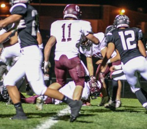 Berthoud's Jimmy Fate crosses the goal line for the Spartan's first score of the game in the 28-14 loss against Roosevelt on Oct. 31.  Jan Dowker / The Surveyor