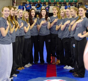 The Berthoud Spartan Volleyball team sings the Star-Spangled Banner for the opening of the Colorado State High School Volleyball Championships. L to r: Haley Hummel, Brooke Thonhoff, Shaylee Pierick, Shelby Braesch, Jessa Megenhardt, Emily Trujillo, Madi White, Hannah Atkinson, Alyssa Peacock, Julie Ward, Abi Lutz, and Sarah Howard. Paula Megenhardt / The Surveyor