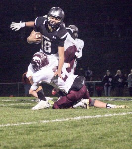 Berthoud's Matt Bonds tackles Roosevelt's Cameron Hurtado on Oct. 31 in Johnstown. Despite losing the game 28-14, the Spartans still made the playoffs and are set to face No. 1 Discovery Canyon this Friday night in Colorado Springs.  Karen Fate / The Surveyor