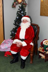 Photos with Santa are always a favorite at the Grace Place Craft Fair. Photo courtesy of LuAnn Hoxeng
