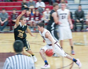 Berthoud's Nathan Hammel makes a move around a Thompson Valley High School defender during a game at Berthoud High School on Dec. 18. Berthoud won the contest 54-52 in large part from Hammel's 21-point contribution.  Angie Purdy / The Surveyor