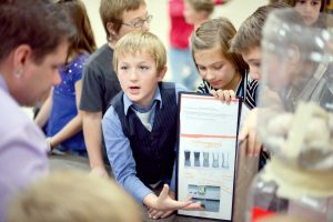 Ivy Stockwell fifth grader Dayde Dorn explains a water filtration project results with teacher Jason Hooker during a presentation at the school on Nov. 20. Included in Dayde's team were classmates Miranda Roth, Grayson Heyart, Cody Duran and Garrett Purman.  John Gardner / The Surveyor
