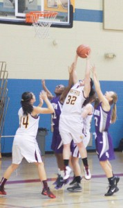 Berthoud's Maria Fate grabs another rebound during the Spartans' Dec. 6 game against Denver South.
