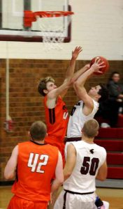 Berthoud's Nathan Hammel goes up for a shot at Tuesday's conference opener at Berthoud High School.  Angie Purdy / The Surveyor