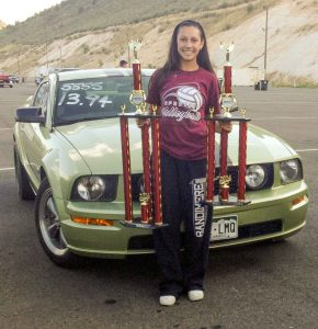 Berthoud's Rheanna Goscha holds a pair of trophies she received at the Labor Day School Days event at Bandimere Speedway in Morrison in 2014. Courtesy photo / The Surveyor