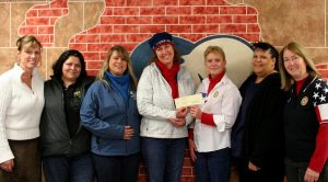 The American Legion Auxiliary Unit 67 in Berthoud presented a check for $1,000 to Hearts & Horses for their Hearts & Horses for Heroes Program. Pictured from L to R, ALA Unit 67 member June Alexander, H&H volunteer Maria Veronica Yzetm, H&H Veterans Outreach Specialist Michele Kane, H&H Exec. Director Jan Pollema, ALA Unit 67 President Laurel Downer, ALA Unit 67 members Gloria Major and Beth Sterck. Jan Dowker / The Surveyor