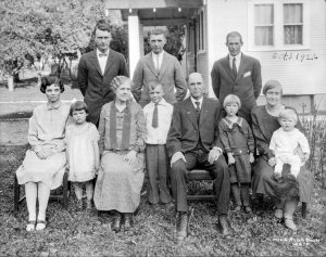 Pictured is Berthoud resident Julia Magee's family. Pictured in the front row, third from the right, is Magee's mother, Emilie Young, between Magee's grandmother, Julia Young, and her great-grandfather, Walter Young. Directly behind Emilie is Magee's grandfather, Clyde Young. Front row, third from the left is Magee's great-grandmother, Anna (Oliver) Young, according to Magee. She's spent years tracing her family's origins as they made their way across the country, preserving the family history for generations to come. Photo courtesy of Julia Magee / The Surveyor