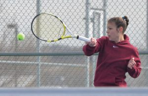 Berthoud's Emily Marty returns a shot to Mountain View's Rebbeca Hinds at Mountain View High School on March 24. Marty won the match in straight sets, 6-0, 6-2. John Gardner / The Surveyor