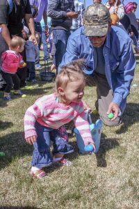 Approximately 2,500 kids between the ages of only a few months, like the little one pictured, to fifth graders participated in the annual Grace Place Easter Egg Hunt hosted at Berthoud High School on the athletic field on Saturday, April 4. Kids gathered up approximately 50,000 artificial eggs stuffed with candy and other goodies as part of the Easter Carnival.   Becky Justice-Hemmann / The Surveyor