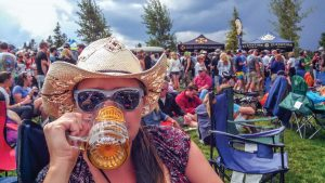 Surveyor contributing reporter and the Mayor of HeidiTown, Heidi Kerr-Schlaefer enjoys a refreshing beverage at a past Winter Park Beer Festival. The Mayor is hosting her first festival, HeidiTown Fest in Ouray over Memorial Day weekend.  Photo courtesy of Heidi Kerr-Schlaefer / The Surveyor