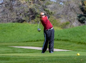 Molli Boruff tees of on the par 5, 12th hole at the Olde Course in Loveland on April 28.  John Gardner / The Surveyor