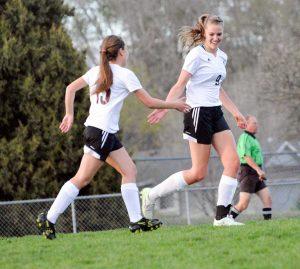 Berthoud's Hannah Stippich (9) celebrates a goal in the first half with Courtney DeMoudt.  John Gardner / The Surveyor