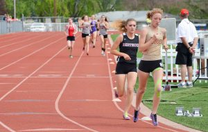 Kiah Leonard paces herself behind Skyline's Sydney Richards in the 3,200 meters on May 2.  John Gardner / The Surveyor