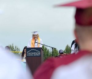 Salutatorian Sage Bowman reads the graduates' names during the presentation of the diplomas on May 23.  John Gardner / The Surveyor