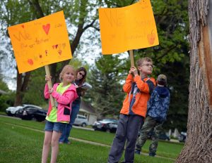 "Ayden Wolf, 9, right, and his sister, Sydney Wolf, 7, both students at Ivy Stockwell Elementary, hold signs in support of Thompson School District Teachers Friday Afternoon at Fickel Park in Berthoud.  A group of local parents and grandparents gathered at Fickel Park on Friday afternoon to gather signatures on a letter of support for Thompson School District teachers. ""We love our teachers and so we're just supporting them,"" said Ayden and Sydney's mother, Jamie Wolf. ""We want the best for them like they want the best for our kids."" John Gardner / The Surveyor"