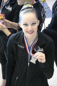 Abby Birdsall is photographed holding her 2015 Junior Olympics silver medal. Photo courtesy of Liz Birdsall / The Surveyor