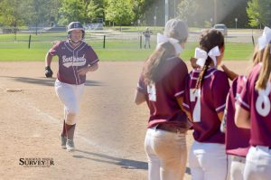 Berthoud first baseman Madison Herbert smiles as she approaches home plate after hitting a solo home run in the fifth inning of the consolation game against Sterling on Sat. Sept., 12, as her teammates lineup to congratulate her. The Spartans finished the tournament in third place, defeating Sterling 7-2. John Gardner / The Surveyor