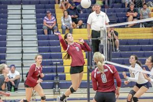 Berthoud's Emily Trujillo, center, goes up for an attack against Frederick at Frederick High School on Sept. 22 as Sarah Howard, left, and Jessa Megenhardt cover the court. The Spartans' victory extended their winning streak to five and lead the Tri-Valley Conference currently. Paula Megenhardt / The Surveyor