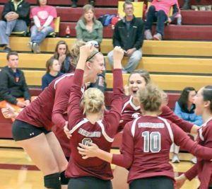 The Berthoud volleyball team celebrates after winning the match against Tri-Valley Conference rivals Windsor at Windsor High School on Oct. 22. Paula Megenhardt / The Surveyor