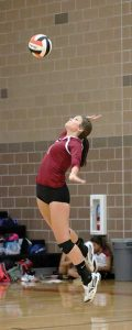 Berthoud's Shay Pierick serves for the Spartans during the match against Mead at Mead High School on Oct. 13. Paula Megenhardt / The Surveyor