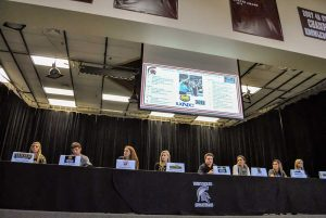 Left to right: Berthoud seniors Taylor Armitage, Isaac Bracken, Kristina Cavey, Kelley Chamberlain, Jimmy Fate, Sydney Kouns, Josie Spitz, and Alyssa Strong prepare to sign their respective letters of intent to continue their athletic careers in college. It was the most Berthoud High School has had sign letters at one time. John Gardner / The Surveyor