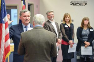 Newly elected Thompson School District Board of Education member David Levy is sworn in at a special organizational meeting on Nov. 19 in Loveland as Jeff Swanty, center, Denise Montagu and Pam Howard, far right, witness in the background. John Gardner / The Surveyor