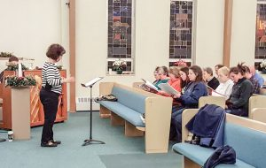 The choir at Berthoud United Methodist Church practices the Christmas Cantata.  May Soricelli / The Surveyor