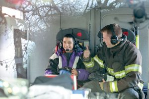 Cisco gets a thumbs-up from firefighter Jonathan Timms inside the firetruck. The Surveyor