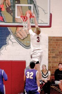 Berthoud's McCallan Castles dunks the ball during the Berthoud Spartans' matchup with Littleton on Dec. 11 at the annual Spartan Classic. Angie Purdy / The Surveyor