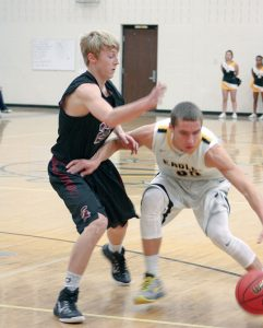 Berthoud's Wyatt Stratmeyer plays defense during the Spartans' loss to Thompson Valley.  Angie Purdy / The Surveyor