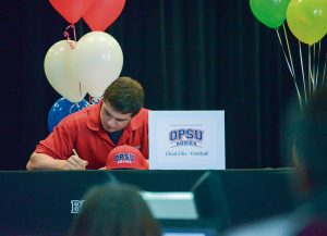 Chad Ellis, a three sport athlete, signs his letter to play football at Oklahoma Panhandle State University.