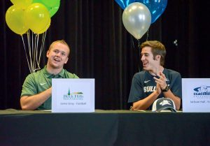 Jamie Gray, left, and Jackson Hall celebrate after Gray officially signed his letter of intent to play football at Black Hills State University.