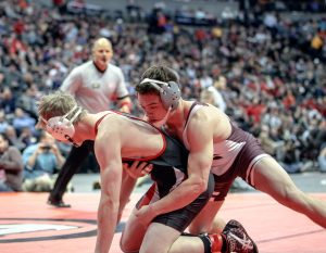 Jimmy Fate wrestles against Steamboat Springs' Hayden Johnson in the championship match on Feb. 20.